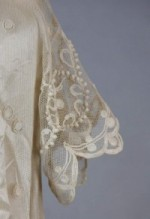 Sleeve detail from Wedding dress, jacket, and slip. Cream linen and taffeta with crocheted lace, 1910.