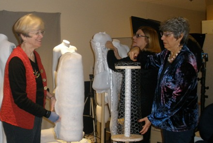 PMH Volunteer Roberta Dumas works with exhibition co-curators Dr. Elizabeth Smalley and Suzanne Ehrmann to prepare the mannequins (Photo by Michelle Turner);